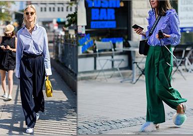 2018春夏街拍时尚搭配中衬衫作为每个女生衣橱必备的经典单品,总是令人着迷,不论是格纹款,还是条纹款,都是既百搭又时髦。舒适的衬衫面料更是让整个春夏楚楚动人!