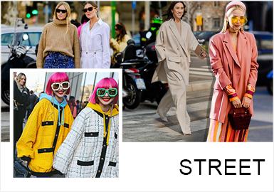 在19/20秋冬米蘭時裝周街拍中,色彩、面料材質、工藝細節、圖案、單品、裝飾細節、風格、搭配等成為了街拍中獨具亮點的元素,讓街拍涵蓋維度更加廣泛。色調上以明亮的色調為主,其中芭比粉在19/20秋冬米蘭時裝周街拍中以耀眼的色調占據主流;拼接手法的運用多以強烈的對比色調、材質等形式呈現;金屬感的面料與亮片繁復的組合等形式,讓街拍的氛圍嚴肅而又活潑,張弛且有度。