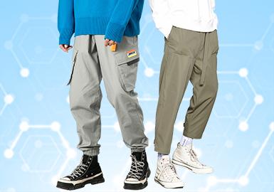 根据POP10月份用户下载量的TOP100男装中长裤数据分析,时尚机能和时尚休闲风格裤装单品相比上月相对持平,而商务休闲类有所上升,工装风与时尚休闲类风格持平。图案类以字母和格纹元素占据,工艺方面,拼接设计依旧占主导地位,少量印花点缀。工装风和时尚机能风依旧成为主流风格,宽松的直筒工装裤也有一定的市场。侧缝拼接增加了裤装的层次感和视觉效果。